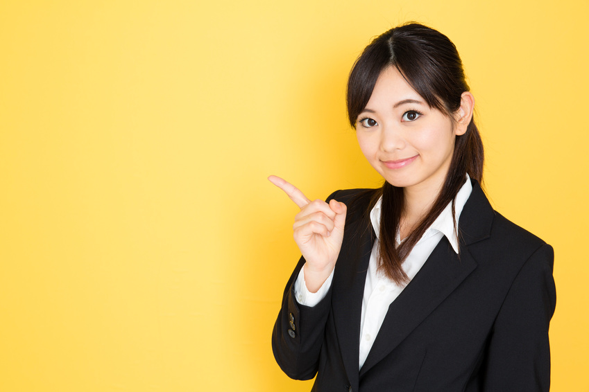 asian businesswoman on yellow background